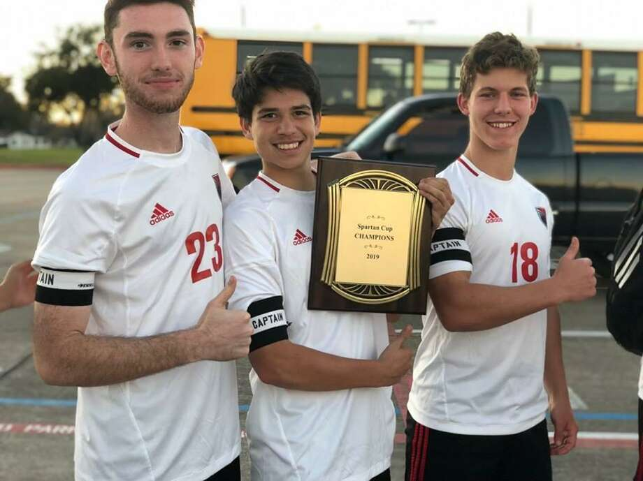 Hargrave boys soccer captains (left to right) Nik Ostenberg, Will Romero, Jackson Kent proudly display the championship plaque that the team got for winning the Spartan Cup in Stafford Photo: Huffman Falconsoccer Facebook Page