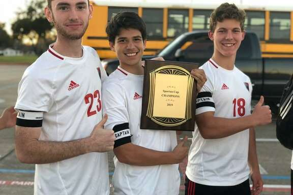 Hargrave boys soccer captains (left to right) Nik Ostenberg, Will Romero, Jackson Kent proudly display the championship plaque that the team got for winning the Spartan Cup in Stafford