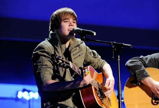 NEW YORK - MARCH 11:  Musician Justin Bieber performs onstage at the Nickelodeon 2010 Upfront Presentation at Hammerstein Ballroom on March 11, 2010 in New York City.  (Photo by Larry Busacca/Getty Images for Nickelodeon) *** Local Caption *** Justin Bieber Photo: Larry Busacca, Getty Images For Nickelodeon / 2010 Getty Images