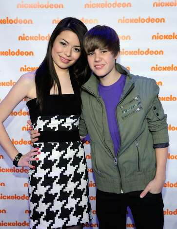 NEW YORK - MARCH 11:  *EXCLUSIVE* Actress Miranda Cosgrove and musician Justin Bieber attend the Nickelodeon 2010 Upfront Presentation at Hammerstein Ballroom on March 11, 2010 in New York City.  (Photo by Larry Busacca/Getty Images for Nickelodeon) *** Local Caption *** Miranda Cosgrove;Justin Bieber Photo: Larry Busacca, Getty Images For Nickelodeon / 2010 Getty Images