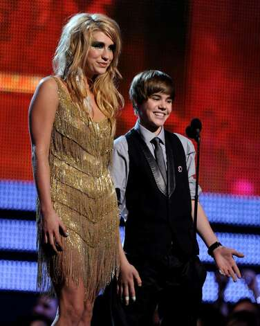 LOS ANGELES, CA - JANUARY 31:  Singers Ke$ha (L) and Justin Bieber speak onstage during the 52nd Annual GRAMMY Awards held at Staples Center on January 31, 2010 in Los Angeles, California.  (Photo by Kevin Winter/Getty Images) *** Local Caption *** Ke$ha;Justin Bieber Photo: Kevin Winter, Getty Images / 2010 Getty Images