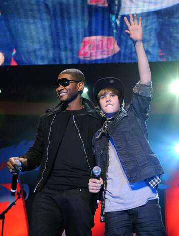 NEW YORK - DECEMBER 11:  Usher and Justin Bieber perform onstage during Z100's Jingle Ball 2009 at Madison Square Garden on December 11, 2009 in New York City.  (Photo by Bryan Bedder/Getty Images) *** Local Caption *** Usher;Justin Bieber Photo: Bryan Bedder, Getty Images / 2009 Getty Images