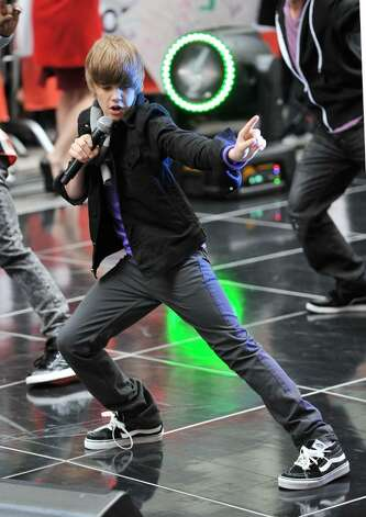 "NEW YORK - OCTOBER 12:  Justin Bieber performs on NBC's ""Today"" at Rockefeller Center on October 12, 2009 in New York City.  (Photo by Andrew H. Walker/Getty Images) *** Local Caption *** Justin Bieber Photo: Andrew H. Walker, Getty Images / 2009 Getty Images"