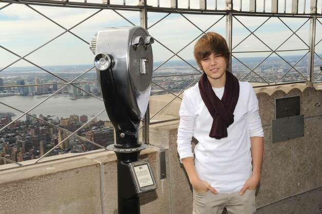 NEW YORK - OCTOBER 08:  Singer Justin Bieber attends the lighting of the Empire State Building to kickoff Jumpstart's Read For The Record Campaign on October 8, 2009 in New York City.  (Photo by Jason Kempin/Getty Images for jumpstart) *** Local Caption *** Justin Bieber Photo: Jason Kempin, Getty Images For Jumpstart / 2009 Getty Images