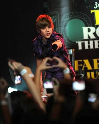 NEW YORK - SEPTEMBER 24:  Recording artist Justin Bieber performs at the 3rd annual Tiki Rocks The Square for the Children's Miracle Network at the Hard Rock Cafe, Times Square on September 24, 2009 in New York City.  (Photo by Jason Kempin/Getty Images) *** Local Caption *** Justin Bieber Photo: Jason Kempin, Getty Images / 2009 Getty Images