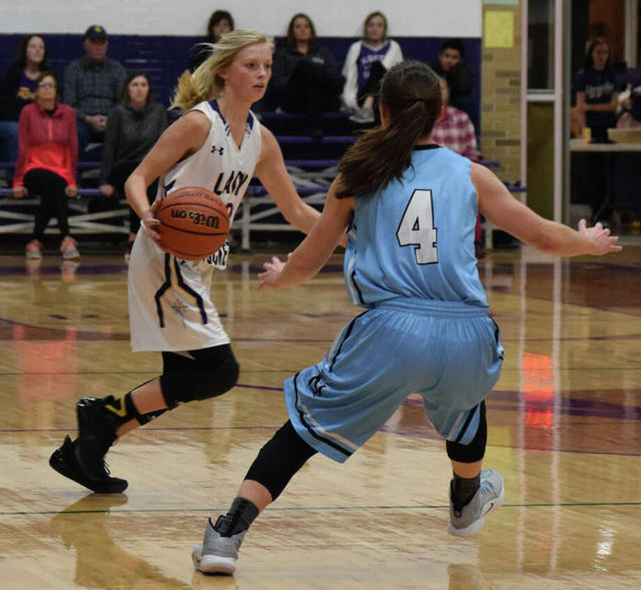 Lacey Schierl brings the ball upcourt Monday at the Routt Dome in a game against North Mac.