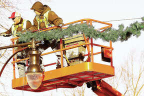 It wasn't exactly the law of gravity in force Tuesday, but Roxana Public Works Department employees were back on the lift proving that what they put up, must come back down. The crews were removing the annual Christmas decorations on Central Avenue.