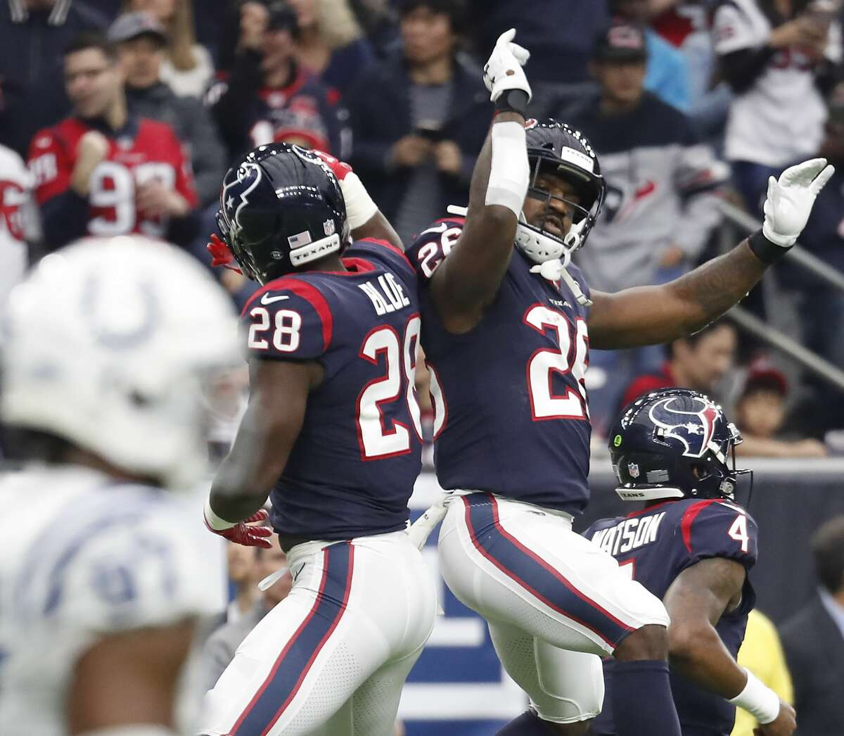 Houston Texans running back Alfred Blue (28) and Houston Texans running back Lamar Miller (26) celebrate Blue's 3-yard touchdown run against the Indianapolis Colts during the first quarter of an NFL football game at NRG Stadium on Sunday, Dec. 9, 2018, in Houston.
