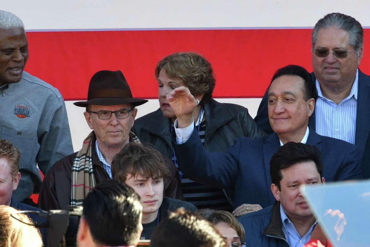 Bexar County Judge Nelson Wolff, in hat, and Henry Cisneros, former secretary of housing and urban development, take their seats onstage before a rally in Guadalupe Plaza on Saturday, Jan. 12, 2019, where Julian Castro is announcing his intention to run for president of United States in the 2020 election.