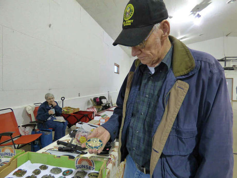 In this Jan. 5, 2019 photo, Bill White shows one of the belt buckles he had for sale at the flea market in First Baptist Church of Energy in Energy, Ill. A few years ago, three ladies at the church began talking about what the church's empty gymnasium could be used for. Then, Linda Garavaglia had an idea. They could host a monthly flea market. At the same time, the church needed a hot water heater. They decided the table rental fees and proceeds from a food stand would go to the church. Photo: Marilyn Halstead/The Southern, Via AP