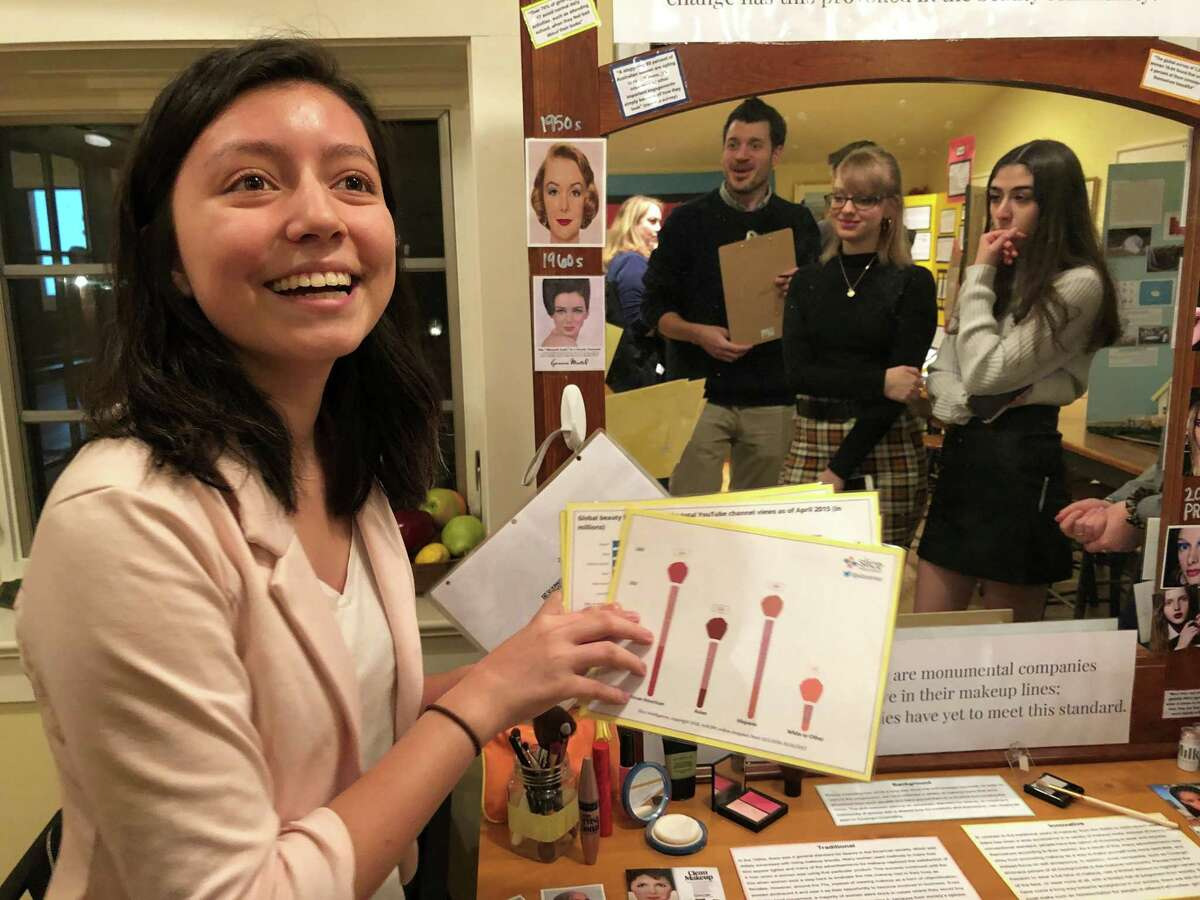 Greenwich High School senior Alexandra Cid presents her findings from a research project.