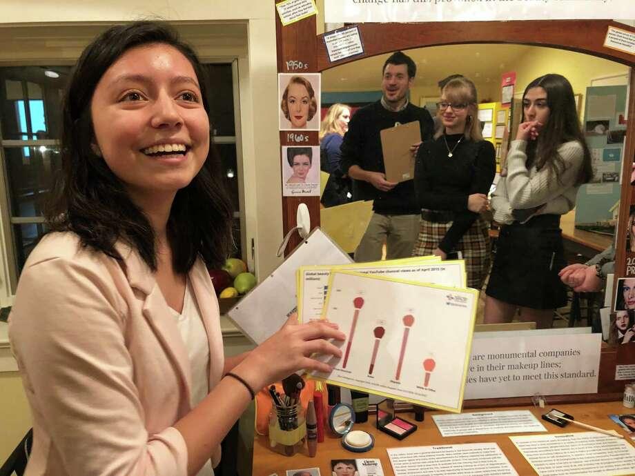 Greenwich High School senior Alexandra Cid presents her findings from a research project. Photo: Jo Kroeker / Hearst Connecticut Media