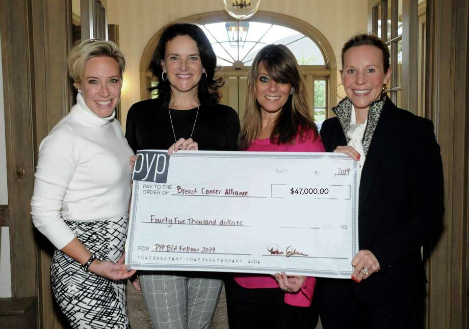 The Breast Cancer Alliance, a Greenwich-based nonprofit, recently received a $47,000 grant from Pitch Your Peers Greenwich. The money will be used to fund a breast surgery fellowship. From left, PYP Greenwich President Nina Lindia, BCA Board President Mary Jeffrey, BCA Executive Director Yonni Wattenmaker and PYP member, and breast cancer survivor, Hillary Corbin, are all on hand for the ceremonial check presentation. Photo: Contributed / /