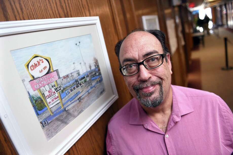 Artist Dave Stannard is photographed by one of two donated oil pastel paintings that hang outside of the Assessor's Office at West Haven City Hall depicting Chick's Drive-In on January 11, 2019. The other depicts The Bilko Company which is slated to be torn down. Photo: Arnold Gold / Hearst Connecticut Media / New Haven Register