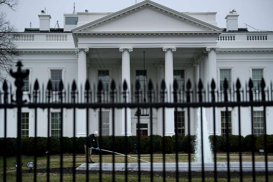 A worker cleans a fountain in front of the White House on the 22nd day of the US government shutdown, January 12, 2019 in Washington, DC. - The partial US government shutdown entered a record 22nd day as President Donald Trump remains steadfast in his demand for $5.7 billion to build a Mexico border wall and Democrats in Congress determined to refuse the funds. (Photo by Brendan Smialowski / AFP)BRENDAN SMIALOWSKI/AFP/Getty Images Photo: BRENDAN SMIALOWSKI, AFP/Getty Images
