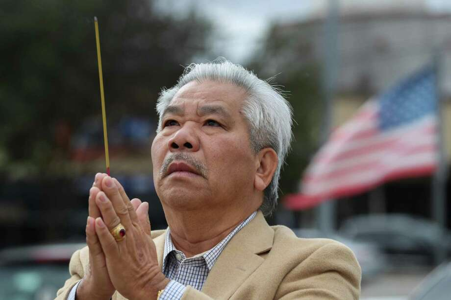Le Ba Hoang offers prayers in front of the Vietnam Memorial before a rally held by HAAPI Youth and community partners Saturday, Jan. 12, 2019, in Houston. The rally was held in light of the United States Administration's heightened attacks to deport impacted Vietnamese and Southeast Asian communities and renegotiating the 2008 United States - Vietnam Repatriation Agreement?. Photo: Steve Gonzales, Houston Chronicle / Staff Photographer / © 2019 Houston Chronicle