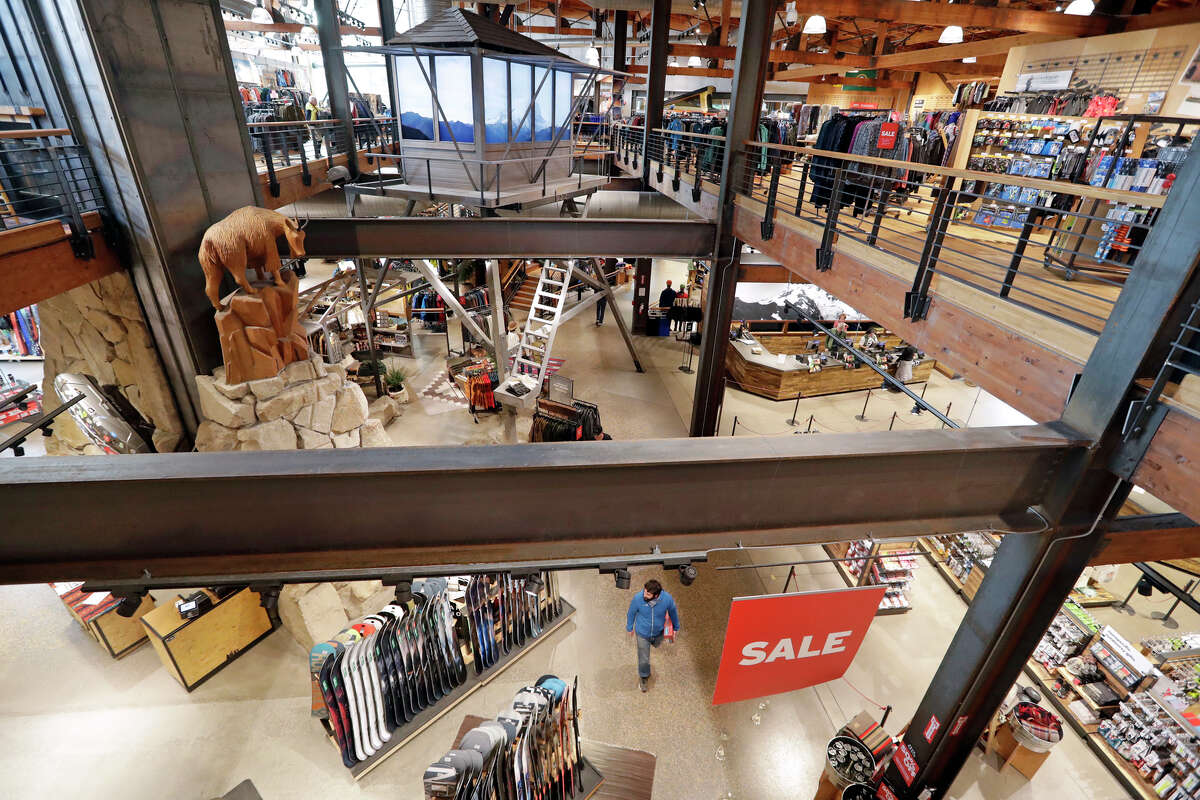 FILE- In this Nov. 13, 2018, file photo a carved mountain goat looks down at the lower level in REI Co-op's flagship store in Seattle.