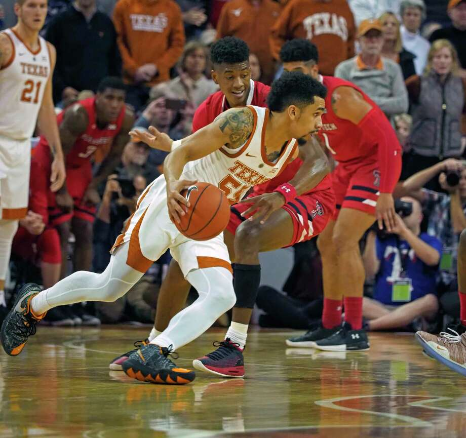 Texas guard Elijah Mitrou-Long, front, drives the ball against Texas Tech guard Jarrett Culver during the first half of an NCAA college basketball game, Saturday, Jan. 12, 2019, in Austin, Texas. Photo: Michael Thomas, AP / Copyright 2019 The Associated Press. All rights reserved.