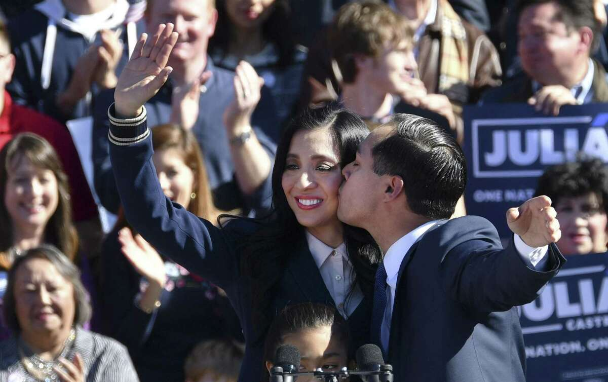 Julian Castro kisses his wife, Erica, after his announcement that he is running for president of the United States in 2020 during a rally at Plaza Guadalupe on Saturday, Jan. 12, 2019. His mother, Rosie Castro, is at lower left.