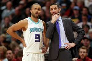 DENVER, COLORADO - JANUARY 5: Tony Parker #9 of the Charlotte Hornets confers with head coach James Borrego in the first quarter against the Denver Nuggets at the Pepsi Center on January 5, 2019 in Denver, Colorado. (Photo by Matthew Stockman/Getty Images)