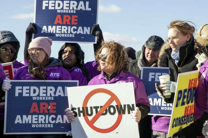 Demonstrators rally against a partial government shutdown at a protest hosted by the National Air Traffic Controllers Association on Capitol Hill in Washington, D.C. on Thursday. MUST CREDIT: Bloomberg photo by Alex Wroblewski