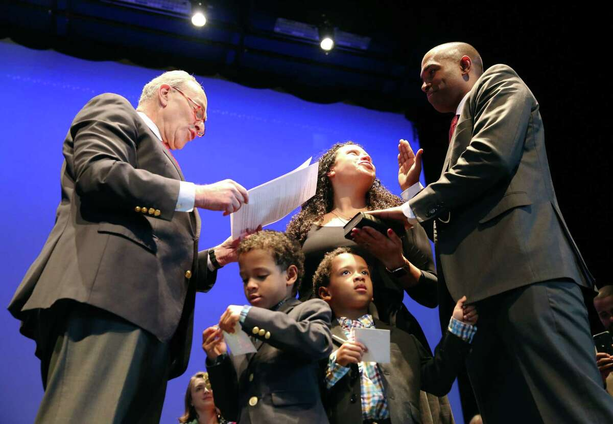 Sen. Chuck Schumer reads the oath during the swearing-in celebration for Rep. Antonio Delgado Saturday, Jan. 12, 2019 at Hudson Hall in Hudson, N.Y. (Phoebe Sheehan/Times Union)