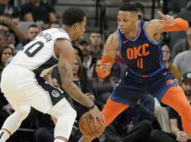 San Antonio Spurs' DeMar DeRozan, left, drives against Oklahoma City Thunder's Russell Westbrook during the first half of an NBA basketball game, Thursday, Jan. 10, 2019, in San Antonio. (AP Photo/Darren Abate)