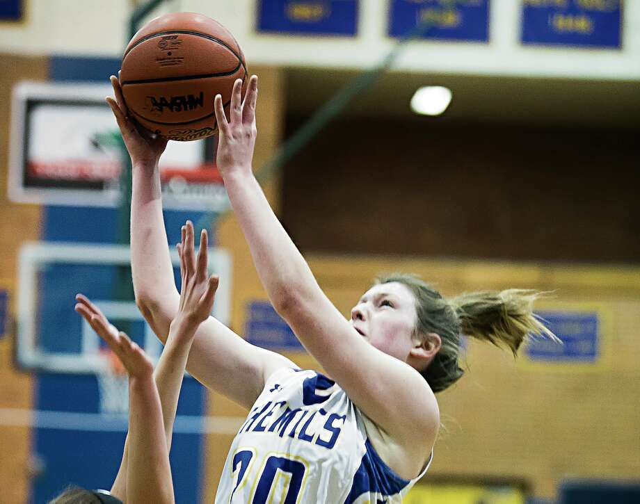 Midland High's Alyssa Chritz goes up for a shot vs. Traverse City West earlier this season. Chritz had 14 points, eight rebounds, and four assists in Saturday's loss to Ypsilanti Arbor Prep. Photo: Daily News File Photo