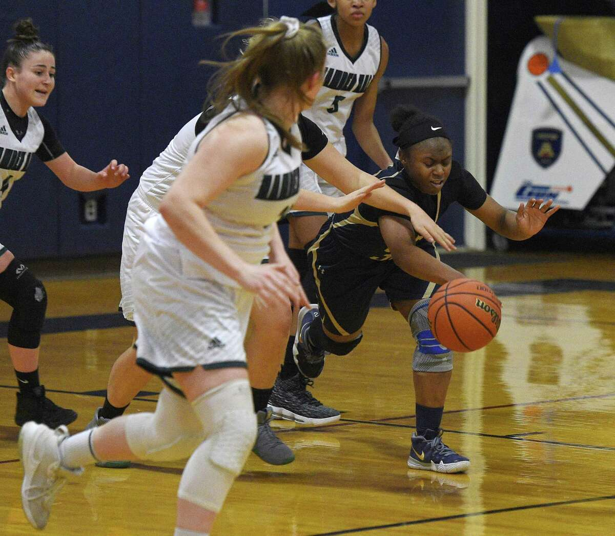 King's Alonna Christy controls the ball in the high school girls basketball game between King School and Hamden Hall at King School in Stamford on Tuesday.