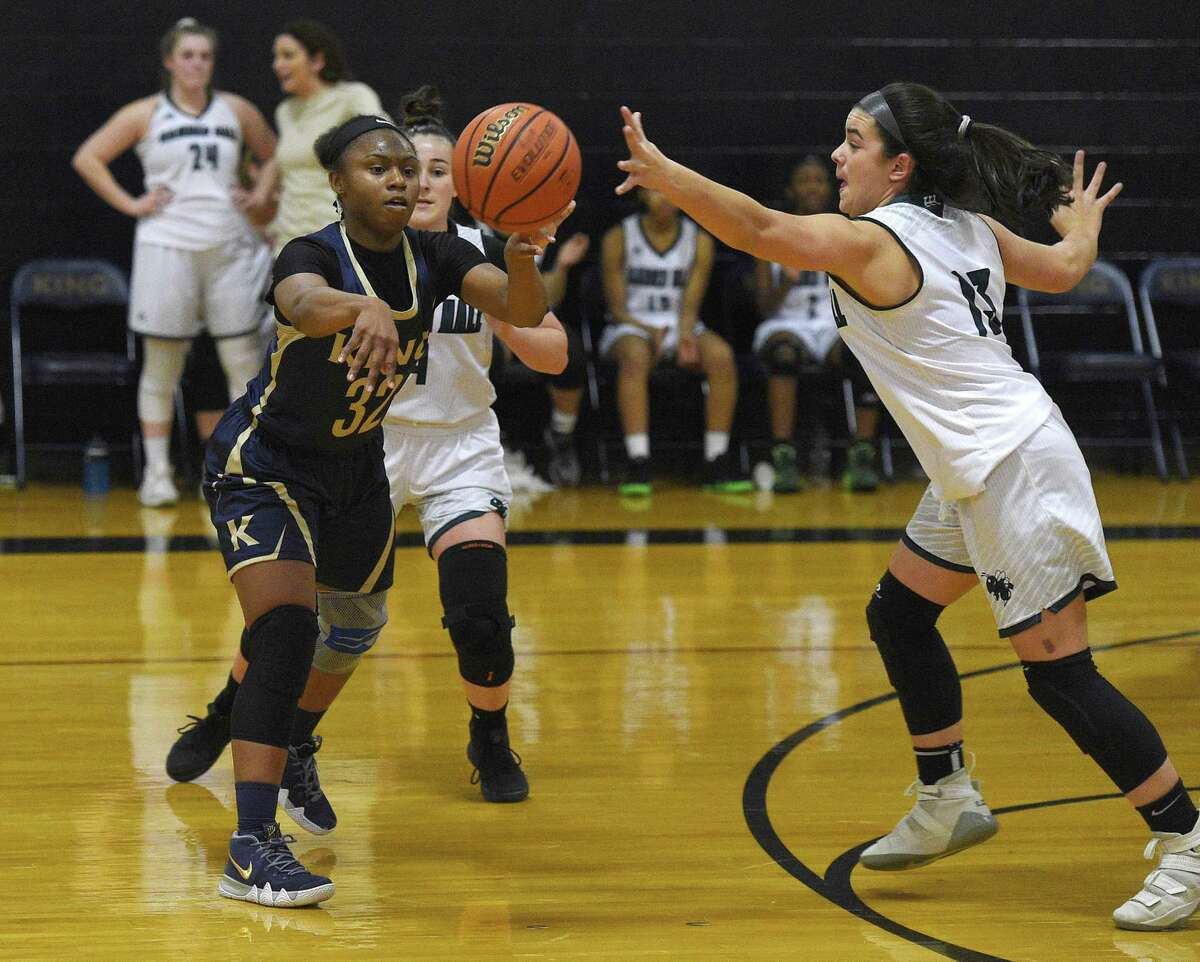 King's Alonna Christy passes against the Hamden Hall defense at King School in Stamford on Tuesday.
