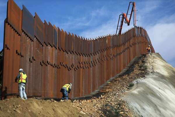 TIJUANA, MEXICO - JANUARY 11: A construction crew works as new sections of the U.S.-Mexico border barrier are installed replacing smaller fences on January 11, 2019 as seen from Tijuana, Mexico. President Donald Trump is holding off from a threatened national emergency declaration to fund a border wall amidst the partial government shutdown. (Photo by Mario Tama/Getty Images)