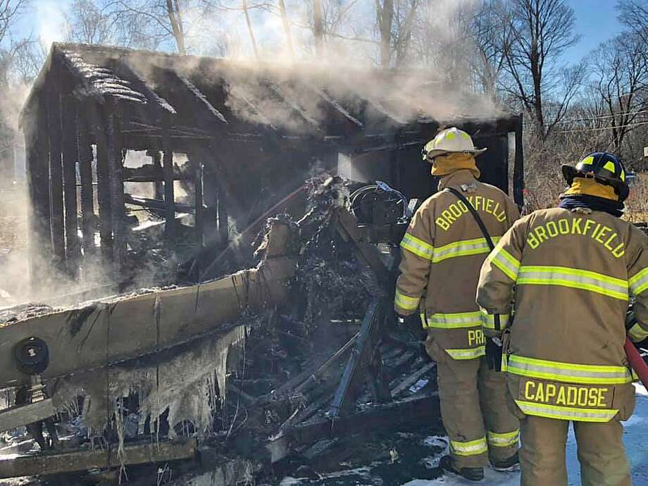 Firefighters extinguished a boat and shed fire in New Milford, Conn., on Jan. 11, 2019. Photo: Contributed Photo / Brookfield Volunteer Fire Company / Connecticut Post Contributed