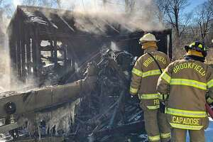 Firefighters extinguished a boat and shed fire in New Milford, Conn., on Jan. 11, 2019.
