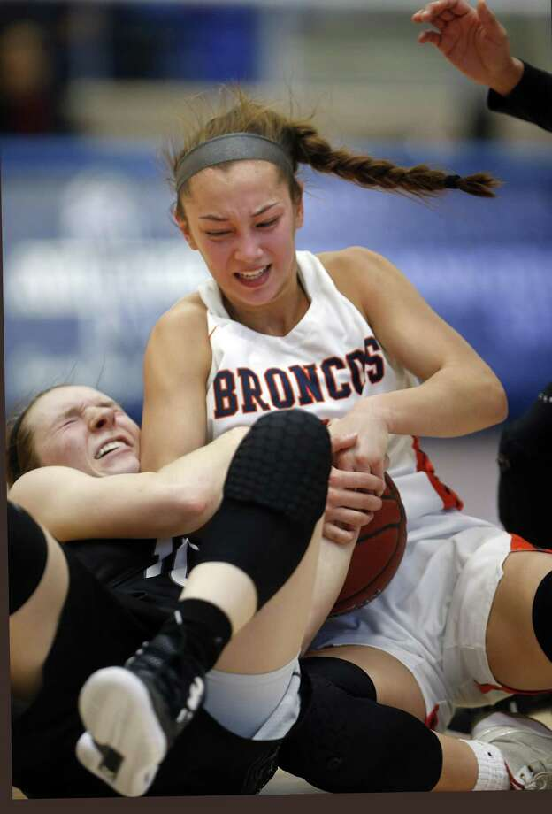 Brandeis' Kaia Herrera battles Clark's Rachel Lee,on floor for a loose ball in girls basketball game on Saturday, January 12, 2019 at Northside Gym. Photo: Ronald Cortes/Contributor / 2019 Ronald Cortes