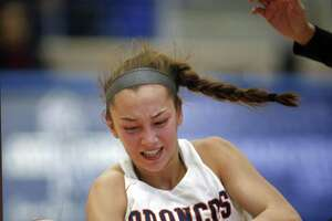 Brandeis' Kaia Herrera battles Clark's Rachel Lee,on floor for a loose ball in girls basketball game on Saturday, January 12, 2019 at Northside Gym.