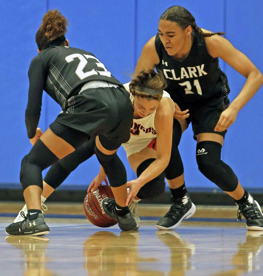 Clark's Ta'Niya Jackson,23, and Kayla Harris try to trap Brandeis Kaia Herrera in girls basketball game on Saturday, January 12, 2019 at Northside Gym. Photo: Ronald Cortes/Contributor / 2019 Ronald Cortes