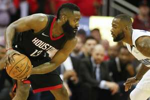 Houston Rockets guard James Harden (13) sizes up Orlando Magic forward Jonathon Simmons (17) in the 4th-quarter of an NBA basketball game at Toyota Center on Tuesday, Jan. 30, 2018, in Houston. ( Steve Gonzales / Houston Chronicle )