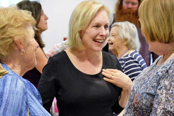 U.S. Senator Kirsten Gillibrand, center, speaks with seniors following her news conference at John F. Kennedy Towers Senior Housing to announce the Stop Price Gouging Act, which would drive down prescription drug prices Friday July 13, 2018 in Troy, NY. (John Carl D'Annibale/Times Union)