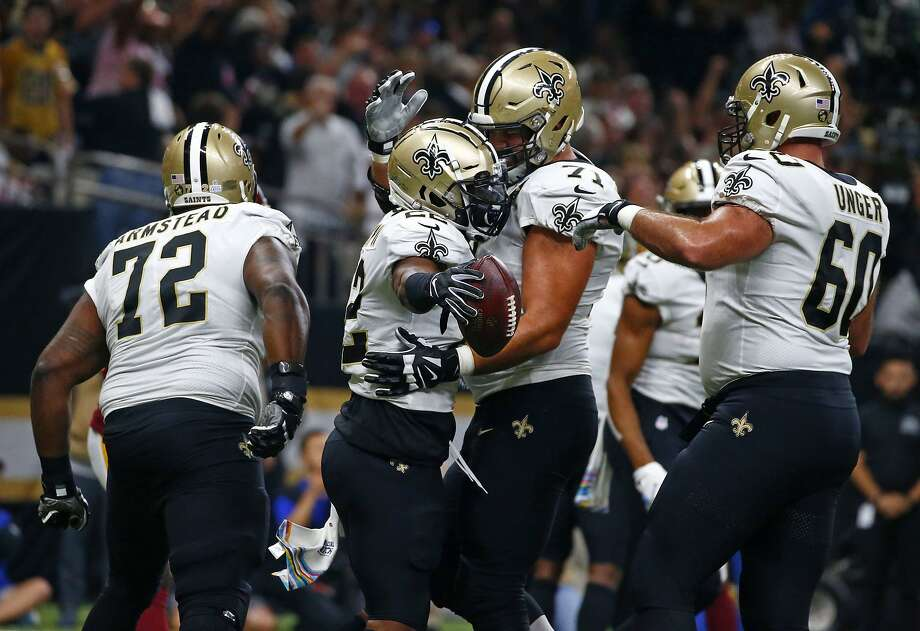 Running back Mark Ingram (second left) rushed for 645 yards and six TDs in the Saints' last 12 games, surpassing 100 yards in a game twice this season. He also caught 21 passes for 170 yards and one TD. Photo: Butch Dill / Associated Press