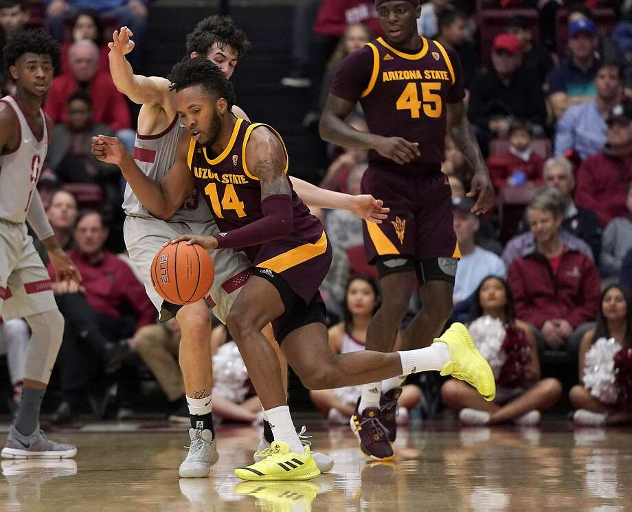 Arizona State forward Kimani Lawrence drives against Stanford guard Cormac Ryan during the first half Saturday. Photo: Tony Avelar / Associated Press