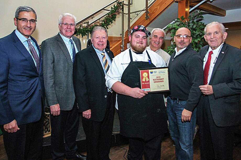The chamber hosted a restaurant showdown to kick off Taste of Middlesex County at Powder Ridge in Middlefield. From left are Vice President, Business Services, Comcast Business, Paul Savas; Middlefield First Selectman Ed Bailey, Chamber Chairman Jay Polke, chef Ryan Clark, MC Al Santostefano, Powder Ridge owner Sean Hayes and Chamber President Larry McHugh. Photo: De Kine Photo LLC / (c)DE KINE PHOTO LLC