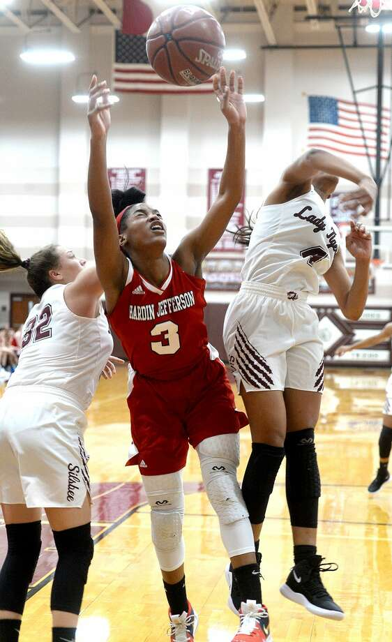 Silsbee's Emily Williamson (left) and Brandis Bass team up to block as Hardin Jefferson's Ashlon Jackson puts up her shot during their district match-up Friday in Silsbee. Photo taken Friday, January 11, 2019 Photo by Kim Brent/The Enterprise Photo: Kim Brent/The Enterprise