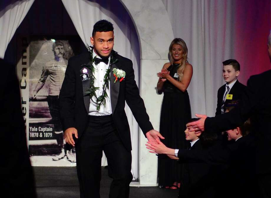 Alabama's Tua Tagovailoa enters to attend the 52nd annual Walter Camp All-Americans black tie Awards Dinner at Yale's Lanman Center in New Haven, Conn., on Saturday Jan. 12, 2019. Tagovailoa was named Player of the Year. Photo: Christian Abraham / Hearst Connecticut Media / Connecticut Post