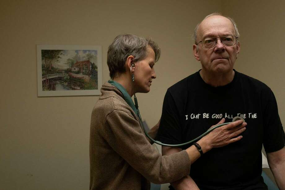 Grace Gosar, co-medical director at the Downtown Clinic in Laramie, Wyoming, listens to the heart of patient Carl Thayer during an exam in December. Photo: Photo By Rachel Woolf For The Washington Post / For The Washington Post