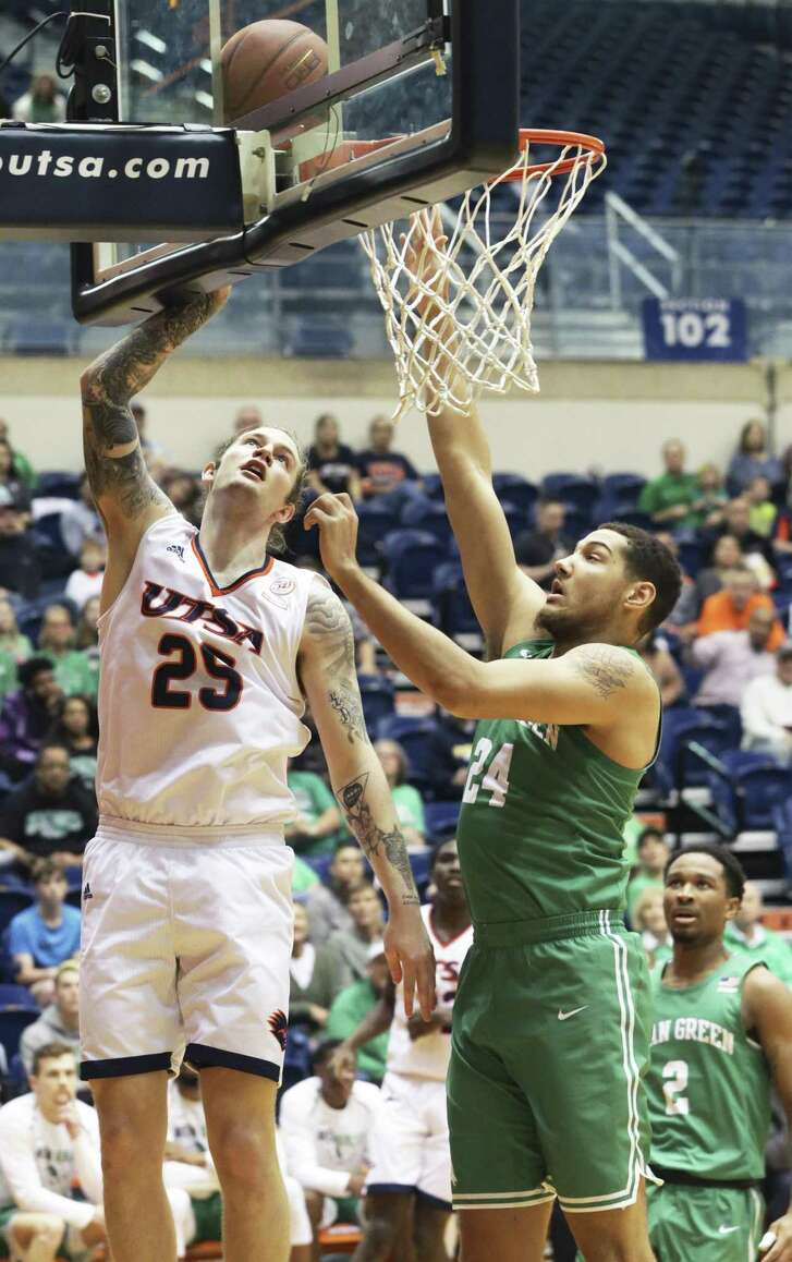 Nick Allen banks a shot in over Zachary Simmons as UTSA hosts North Texas at the Convocation Center on January 12, 2019.