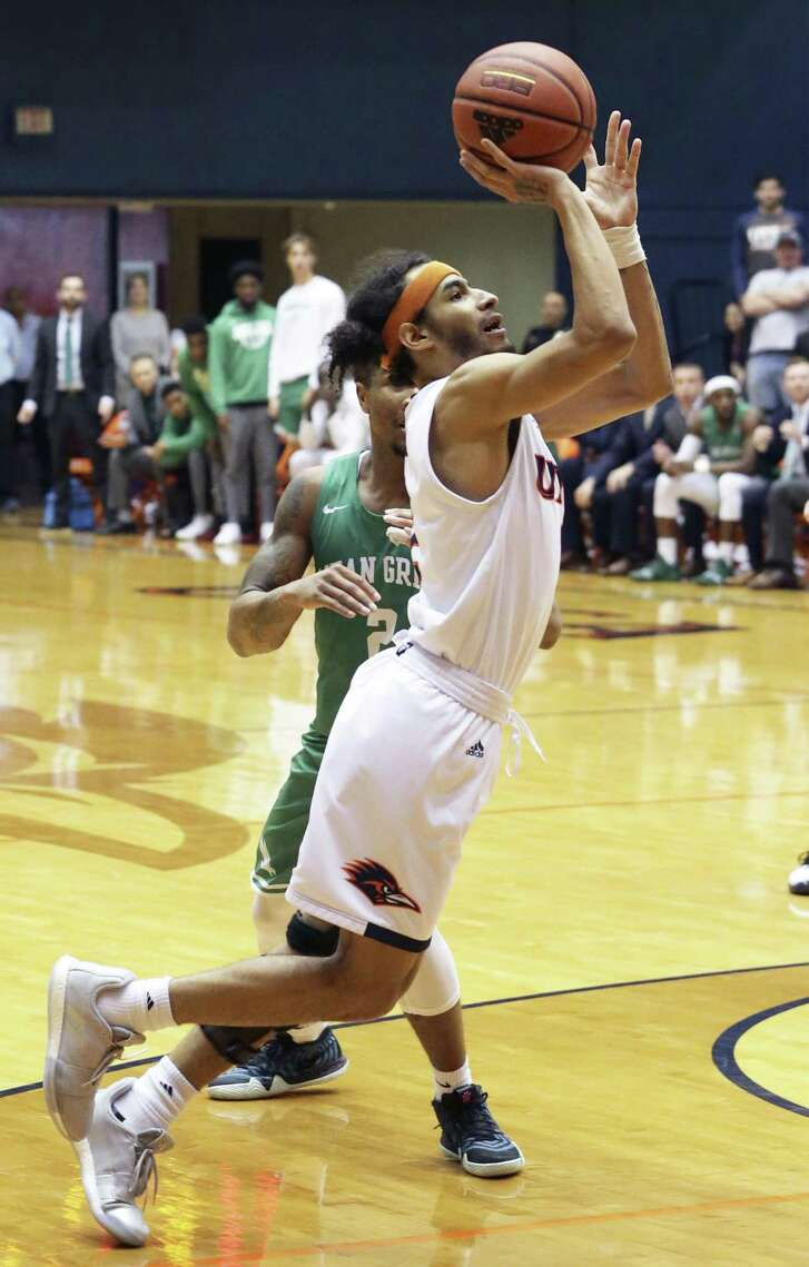 Jhivvan Jackson turns away from Jorden Duffy and hits the game winning shot as UTSA beats North Texas 76-74 at the Convocation Center on January 12, 2019.