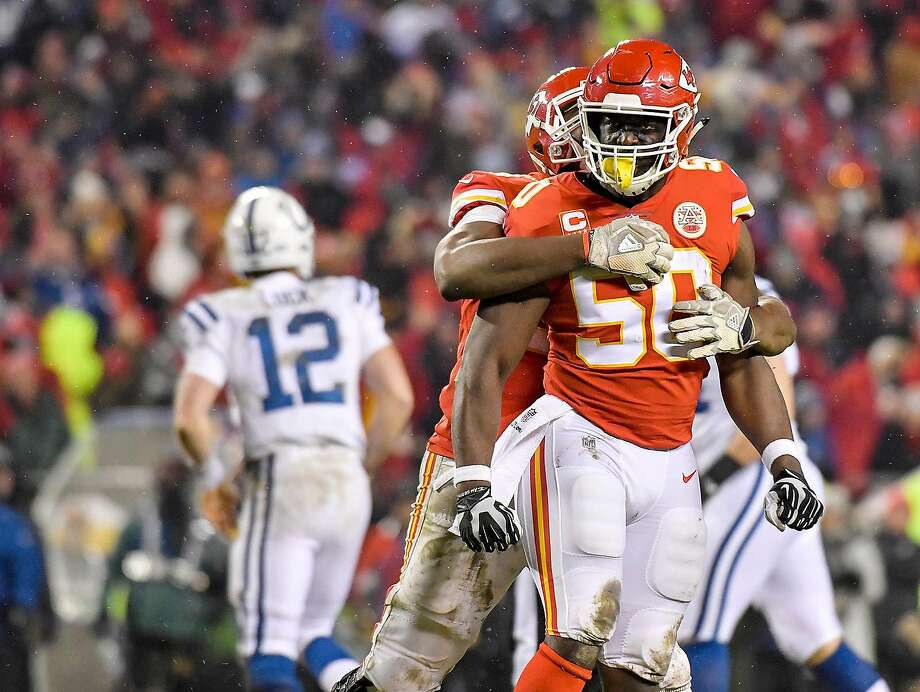 Chiefs outside linebacker Justin Houston (50) is congratulated by defensive end Chris Jones after Houston sacked Indianapolis Colts quarterback Andrew Luck (12) in the third quarter. Photo: John Sleezer / TNS / Kansas City Star
