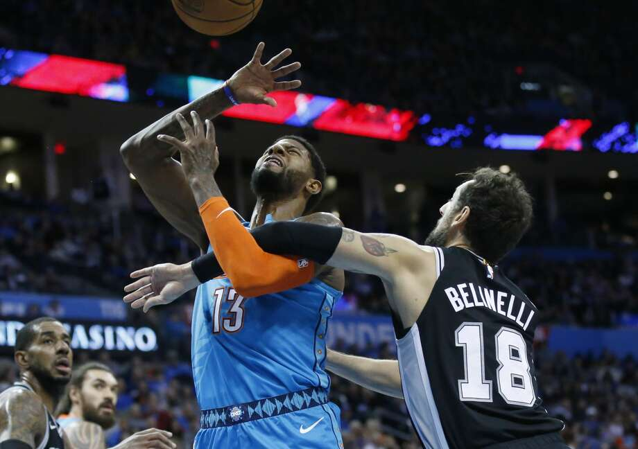 Oklahoma City Thunder forward Paul George (13) loses the ball as he is fouled by San Antonio Spurs guard Marco Belinelli (18) in the first half of an NBA basketball game in Oklahoma City, Saturday, Jan. 12, 2019. (AP Photo/Sue Ogrocki) Photo: Sue Ogrocki/Associated Press
