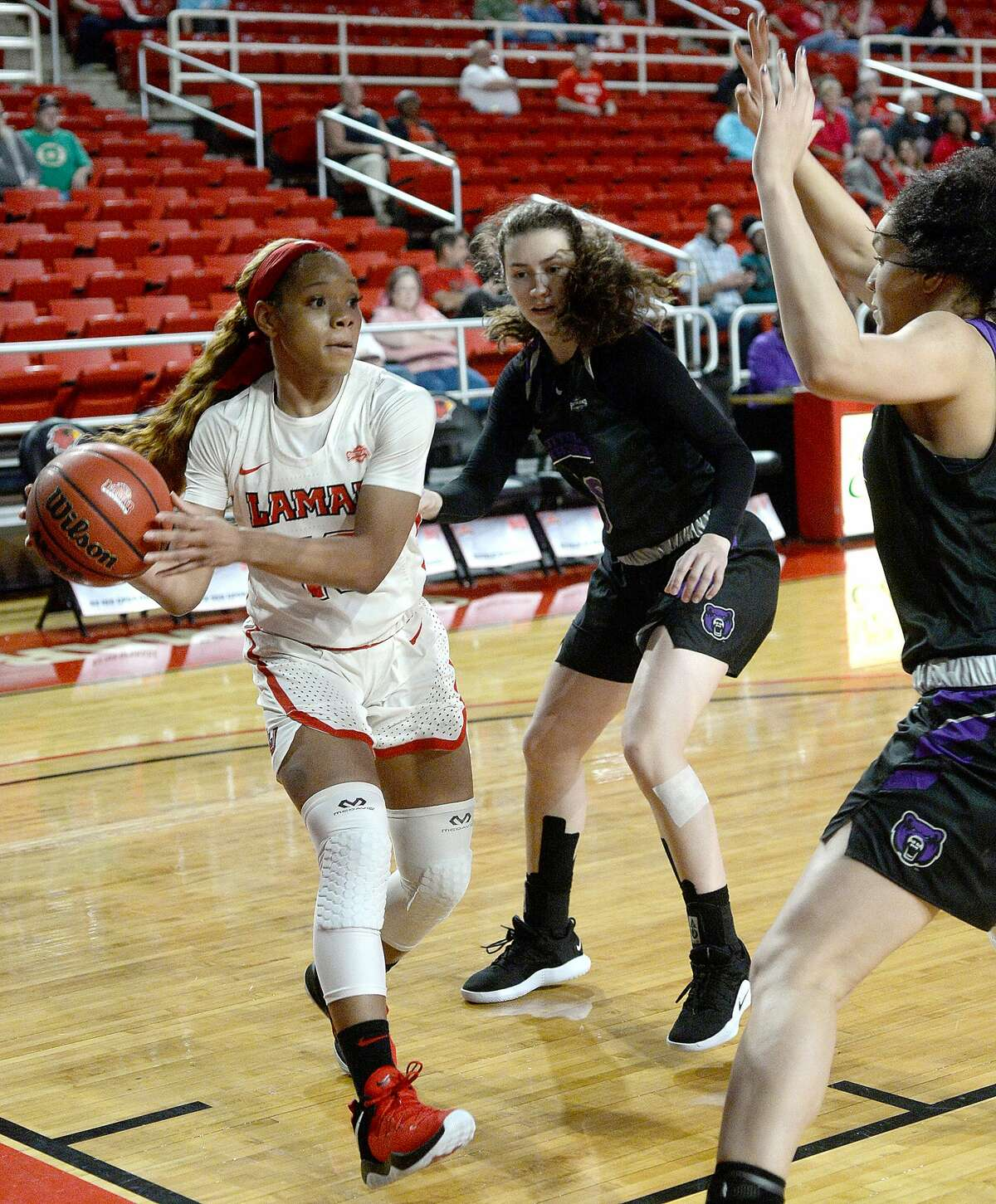 Lamar's Chastadie Barrs is pressed by Central Arkansas' Antonija Bozic and Mekaylan Hicks as she looks to get into the paint during their match-up at the Montagne Center Saturday. Photo taken Saturday, January 12, 2019 Photo by Kim Brent/The Enterprise