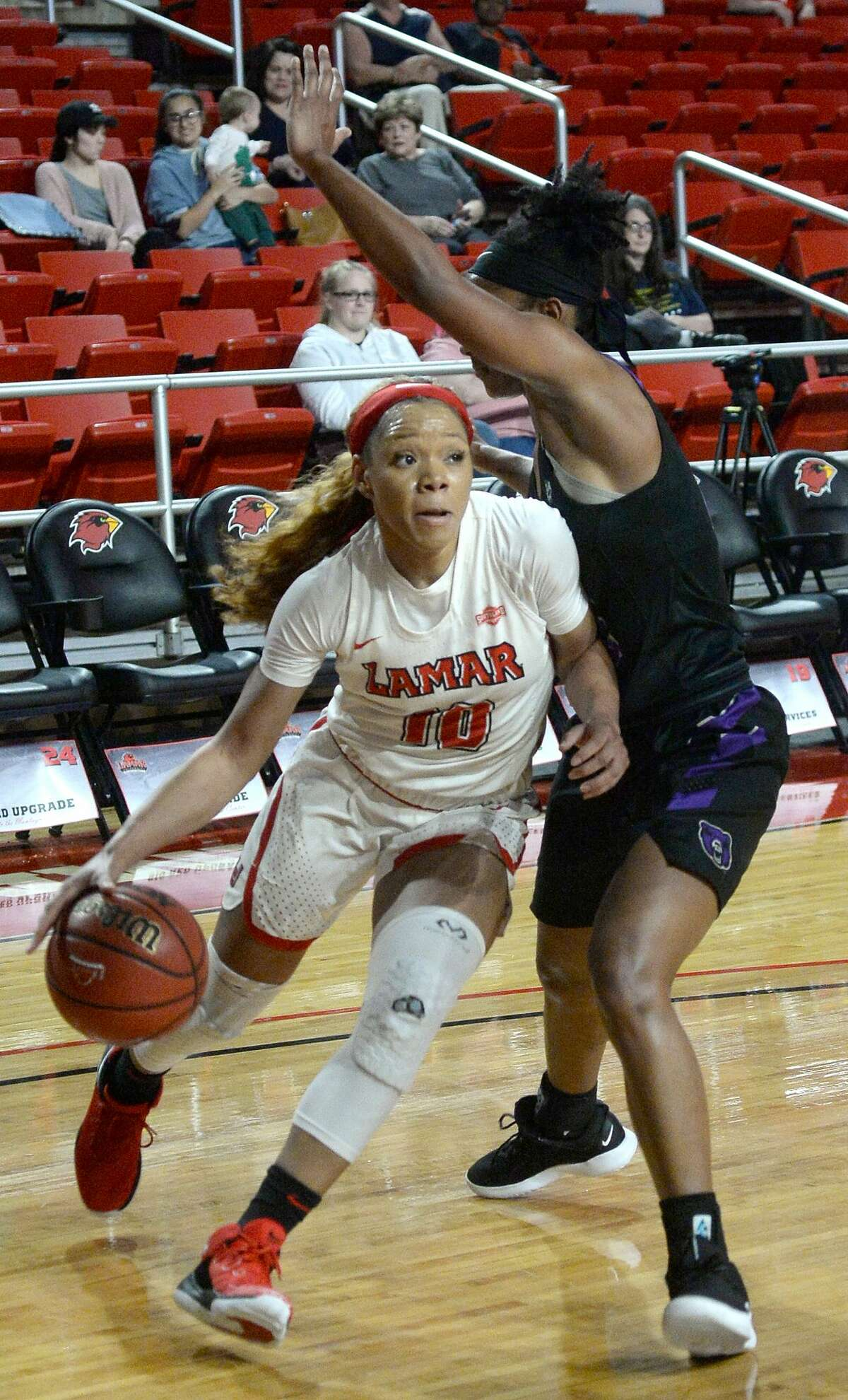 Lamar's Chastadie Barrs drives past Central Arkansas' defense during their match-up at the Montagne Center Saturday. Photo taken Saturday, January 12, 2019 Photo by Kim Brent/The Enterprise